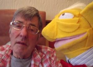 Ken the puppet sings Rock n Roll.